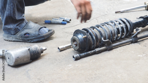 Photo Mechanic he unscrew the shock absorber replacement
