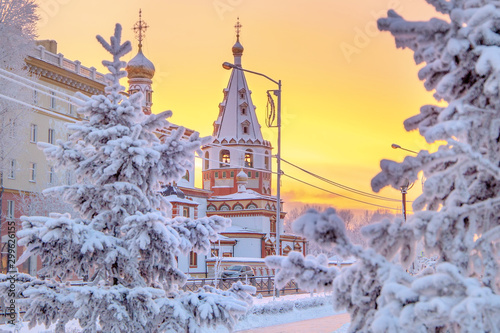 Foto auf Leinwand Gelb Schwefelsäure Winter sunset landscape of frosty trees, white snow in city park. Trees covered with snow in Siberia, Irkutsk near lake Baikal. Extremely cold winter