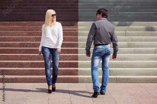 obraz PCV Young fashion couple flirting on city street