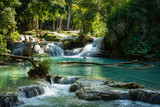 Turquoise water of Kuang Si waterfall, Luang Prabang, Laos. Tropical rainforest. The beauty of nature.