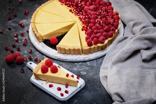 fresh french tart with raspberries and lemons on dark background Fototapeta