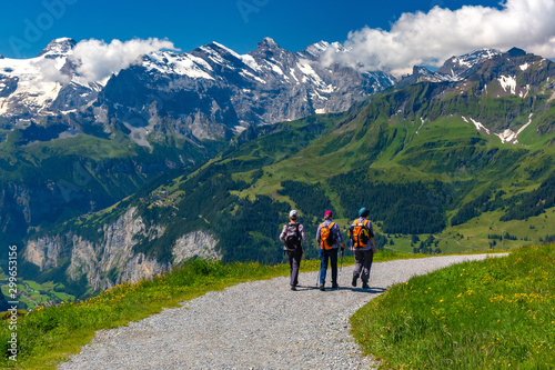 Tourists on hiking trail on mountain Mannlichen, popular viewpoint in Swiss Alps, Switzerland Fototapeta
