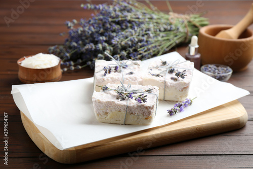 Fototapety, obrazy: Hand made soap bars with lavender flowers on wooden table