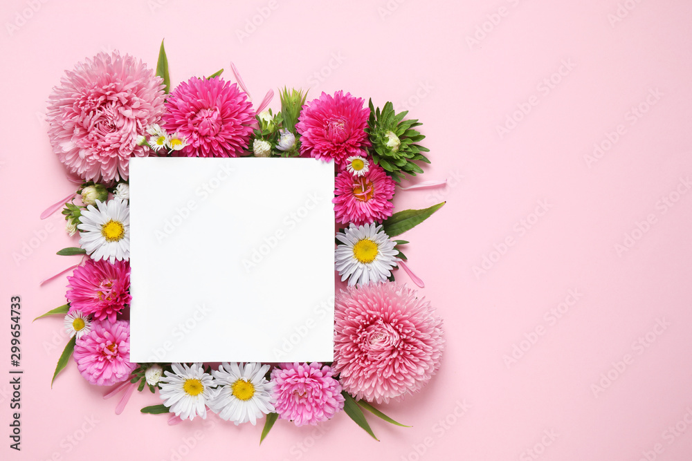 Fototapeta Flat lay composition with beautiful aster flowers and blank card on pink background. Space for text