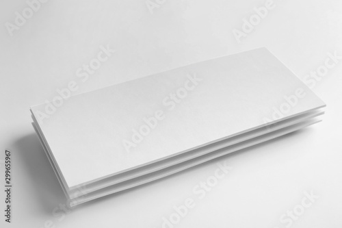Valokuva  Blank palm cards on white background. Mock up for design