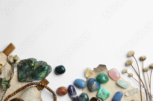 Obraz Composition with different gemstones on white background, top view - fototapety do salonu