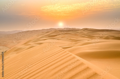 Sunset at the Edge of the Rolling Sand Dunes in the Empty Quarter (Arabian Desert) outside Abu Dhabi, United Arab Emirates