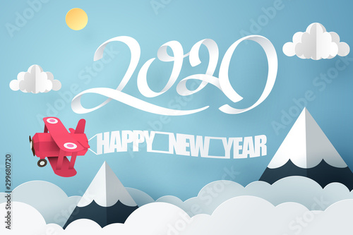 Cuadros en Lienzo  Paper art of 2020 happy new year with red plane flying in the sky