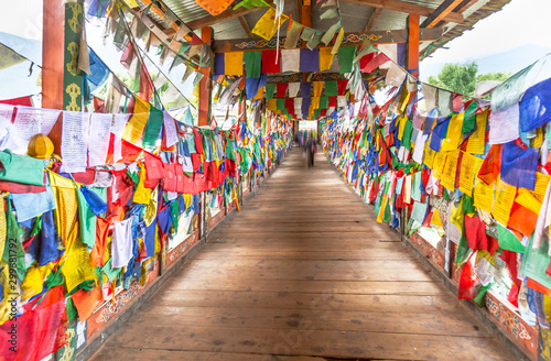 Colorful Buddhist prayer flags on wooden bridge walk way to Monastery in Thimpu, Wallpaper Mural