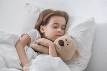 Cute Little Girl In Bed With S...