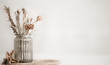 Leinwanddruck Bild - Still life beautiful vase with dried flowers .