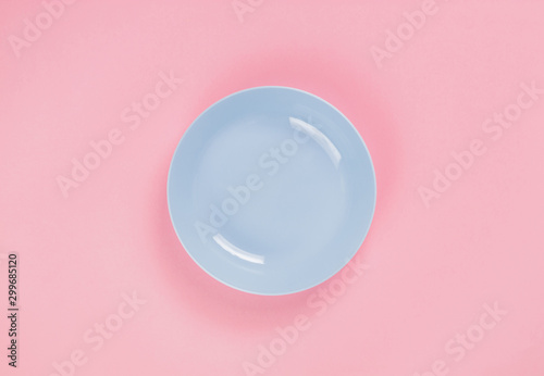 Blue plastic plate on pink background Canvas Print