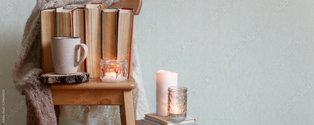 Fototapety, obrazy: hygge and cozy home concept - books, cup of coffee or hot chocolate and candles, seasonal autumn fall winter relax time, concept of read, monochrome, banner