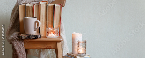 Foto op Plexiglas Chocolade hygge and cozy home concept - books, cup of coffee or hot chocolate and candles, seasonal autumn fall winter relax time, concept of read, monochrome, banner