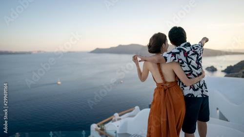 Fototapeta Asian Couple enjoying View Oia village in Santorini island, Greece. obraz