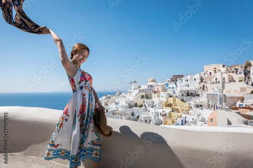 Fototapeta Happy young Woman Enjoying View Oia village in Santorini island, Greece. obraz