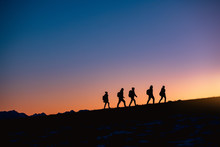Group Of Hikers At Sunset Mountain