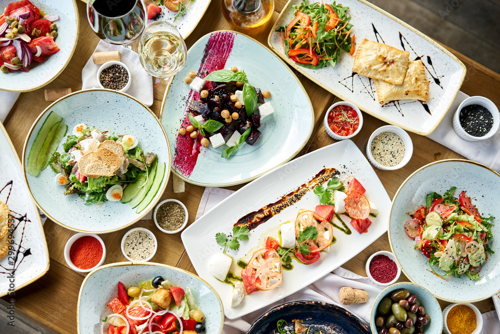 Fototapety, obrazy: Variety of dishes on the table. Various snacks and antipasti on the table. Restaurant menu. Italian cuisine