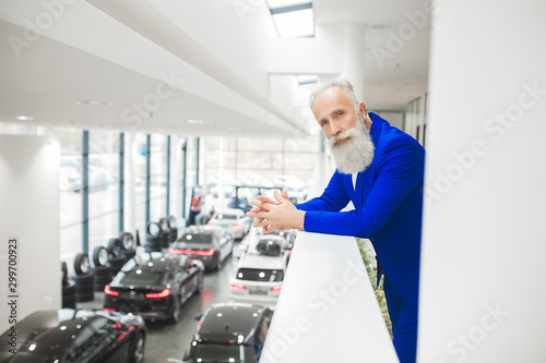 Fototapety, obrazy: Old stylish man in the luxury car. Male with beard and mustash driving automobile. car sales salon.