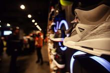 White Sneakers On Street Windo...
