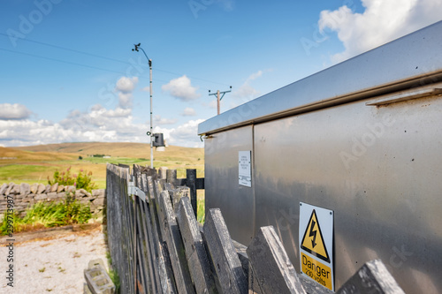 Shallow focus of an electrical power generator and transformer seen within a North Yorks railway station Canvas Print