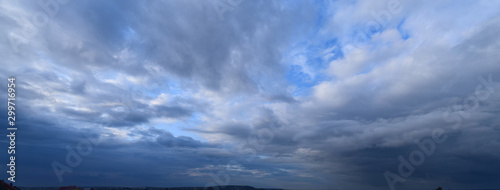 Obraz Heavy rain clouds. Photography, atmospheric phenomena, panoramic image of the autumn sky. - fototapety do salonu