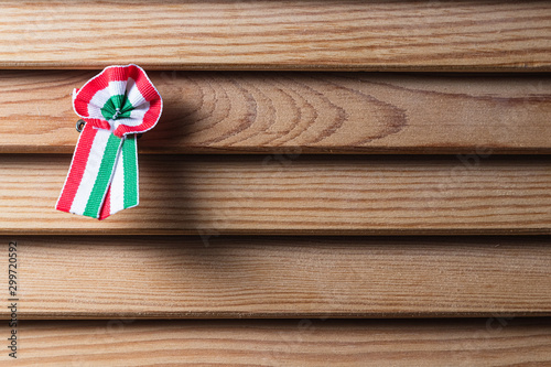 Fototapeta  Hungarian cockade on wooden seamless background