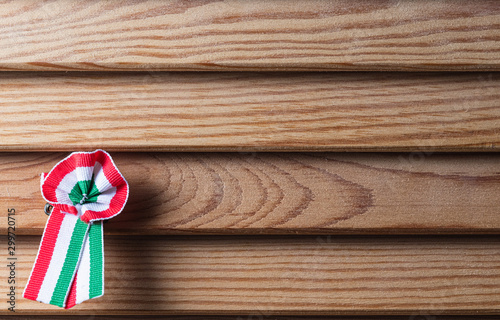 Obraz na plátne  Hungarian cockade on wooden seamless background