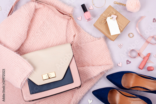 Obraz Flat lay of woman clothing and accessories in pastel colors - fototapety do salonu