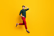 Full length profile side photo of charming elegant guy feel dreamy expression jump run wear casual style outfit sneakers isolated over yellow color background