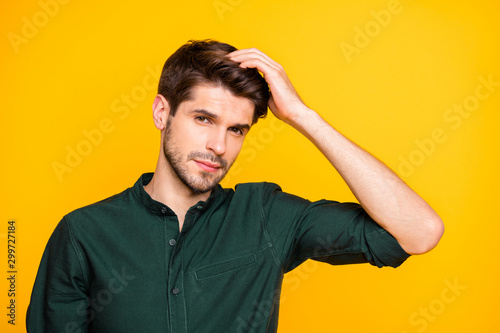 Vászonkép Close up photo of virile confident man touching his hair worried about its falli