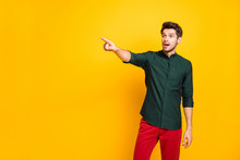 Photo Of Amazed Man In Stupor Pointing At Empty Space After Seeing Incredible Sales Discount With Astonishment On Face Isolated Vivid Color Background