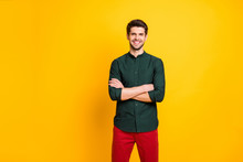 Photo Of Cheerful Positive Nice Man With Good Mood Standing Confidently With Arms Crossed Smiling Toothily With Bristle Growing On Face Wearing Red Pants Isolated Vibrant Color Background