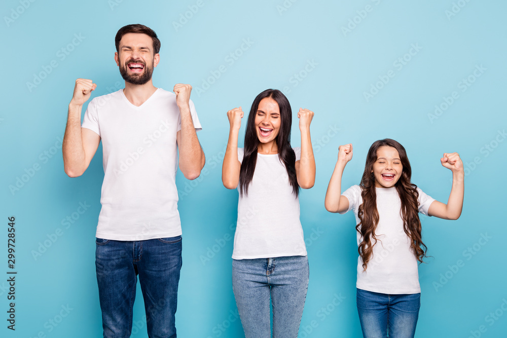 Fototapety, obrazy: Portrait of delighted mommy daddy girl with brunette hair celebrate triumph reaise fists scream yeah wear white t-shirt denim jeans isolated over blue color background
