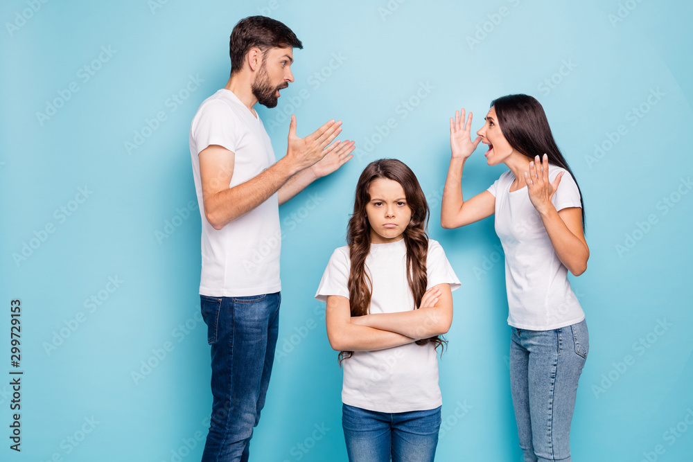 Fototapeta Family everyday insults. Profile side photo of outraged mom dad with brunet hair argue have disagreement and offspring annoyed wear white t-shirt denim jeans isolated over blue color background