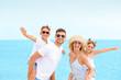 canvas print picture - Portrait of happy family on sea beach