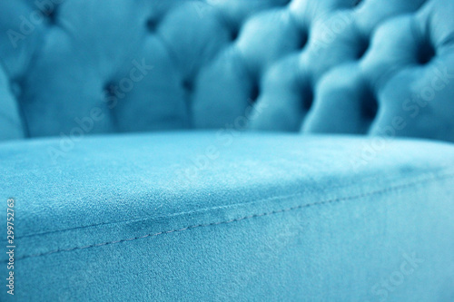 Obraz Detail of classical furniture, selective focus. Velour sofa close-up with part of the seat. Turquoise padded fabric upholstery of the sofa. Turquoise velvet with buttons on the upholstered furniture. - fototapety do salonu