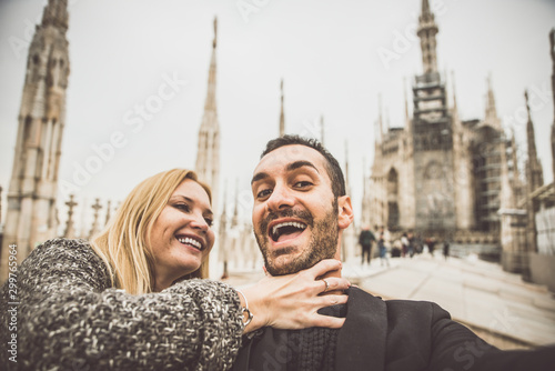 Happy couple having fun with selfies on the top of the cathedral Fototapet