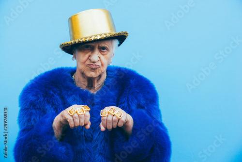 Fototapeta Grandmother portraits on colored backgrounds