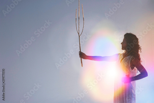 Cuadros en Lienzo Spiritual woman holding an organic plant branch like a scepter
