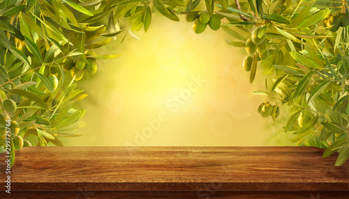 Fototapeta Mockup of empty table with olives branches with fresh olives on yellow background. obraz