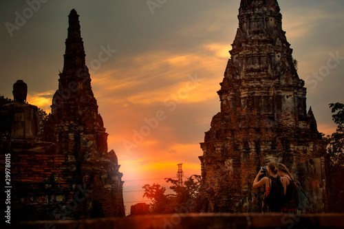 tourist taking a photo in wat chai wattanaram ayutthaya world heritage site of u Wallpaper Mural