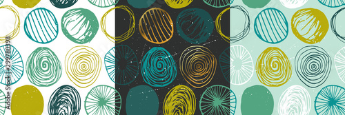 Beautiful vector set of three seamless grunge patterns in blue and green colors. Endless texture with abstract hand drawn round shapes. Repeating wallpapers. Trendy background design.