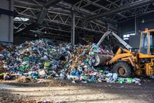 Excavator Stacks Trash In Big ...
