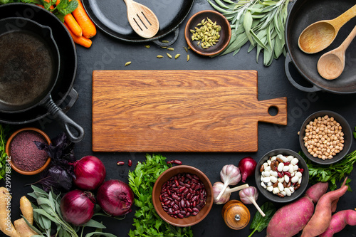 Dark culinary background with healthy food ingredients Fotobehang