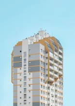 White And Beige High-rise Building