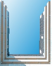Worms-eye-view Photography Of White And Beige Building