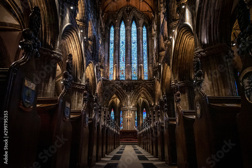 Poster de jardin Lieu de culte GLASGOW, SCOTLAND, DECEMBER 16, 2018: Magnificent perspective view of interiors of Glasgow Cathedral, known as High Kirk or St. Mungo, with huge stained glasses. Scottish Gothic architecture.