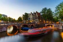 Keizergracht Canal At Dusk, Trailing Light Blur From A Tourist Boat, Amsterdam, North Holland, The Netherlands
