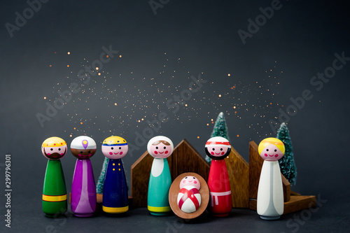 Christmas nativity scene of born child baby Jesus Christ in the manger with Joseph and Mary and Three wise men.Traditional Christmas Nativity Scene of baby Jesus in the manger with Mary and Joseph. - 299796301